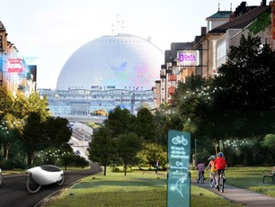 Kids are biking on a road towards Globen. Around them are smart digital signs and vehicles