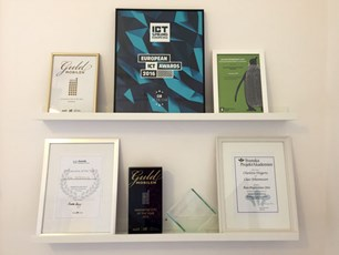 Shelves filled with framed awards